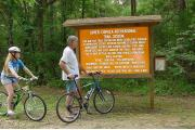 Bicyclists pause to study the informational kiosk before starting out on one of the trails that comprise the park's 6.5 miles of trails. The multiuse trails are enjoyed by hikers, joggers, bicyclists and horseback riders.