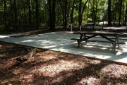 ADA-Accessible site with concrete pad, picnic table and ground grill. RVs only.