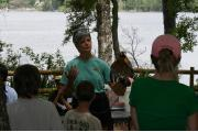 A park volunteer delivers an interpretive program on wildlife along the high banks of Fred Gannon Rocky Bayou State Park.