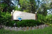 Main entrance sign with manatee shape at Blue Spring State Park.