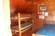 Photo: 004, PRIM. Cabin #4 at Oleta River has a set of bunk beds and a double bed.
