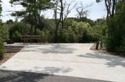 ADA-Accessible site with concrete pad. RVs only.