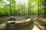 Photo: BADIN LAKE GROUP CAMP: Stone cooking area with picnic tables